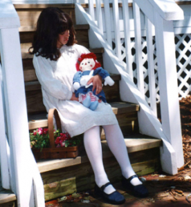 child with raggedy ann