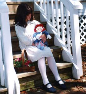 child with raggedy ann